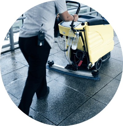 cleaner pulling a commercial cleaning machine